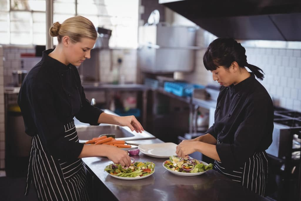 Chef apprentice preparing food